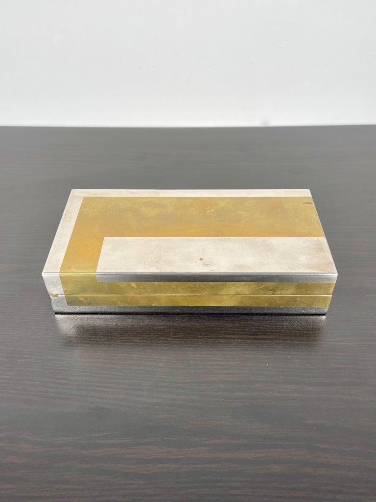 1970s chrome and brass box with black acrylic interior by the Italian designer Romeo Rega. His signature is engraved on the box as shown in photos.