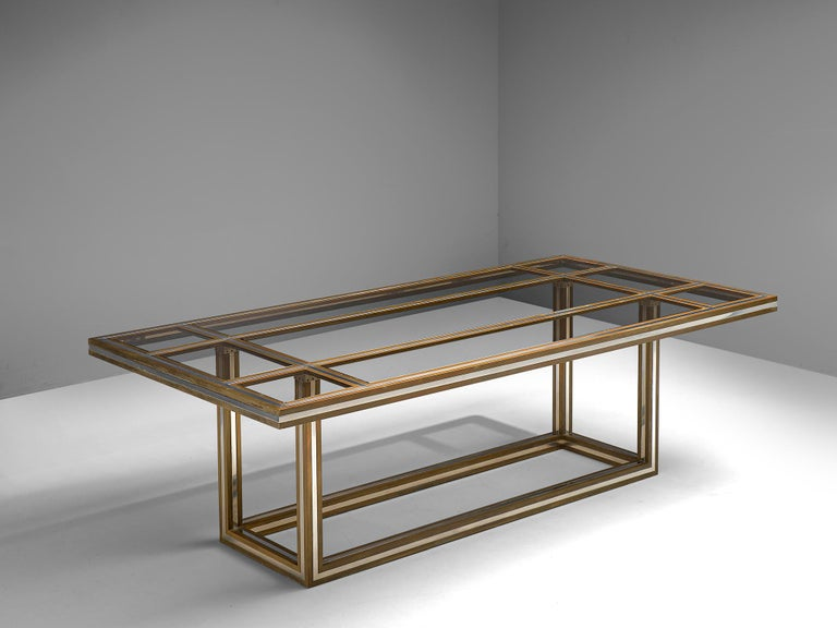 Romeo Rega, dining table, glass, metal and brass, Italy, 1970s  Exquisite brass and metal dining or conference table by Romeo Rega is from the 1970s. The table features a geometric, clean-lined frame. The top is inlayed with smoked glass of