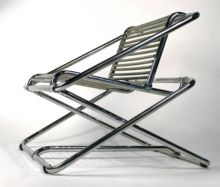A rare chrome-plated bent tubular steel rocking chair with PVC-covered galvanized springs. Manufactured by One Off, Ltd., UK. From a series of approximately 70.