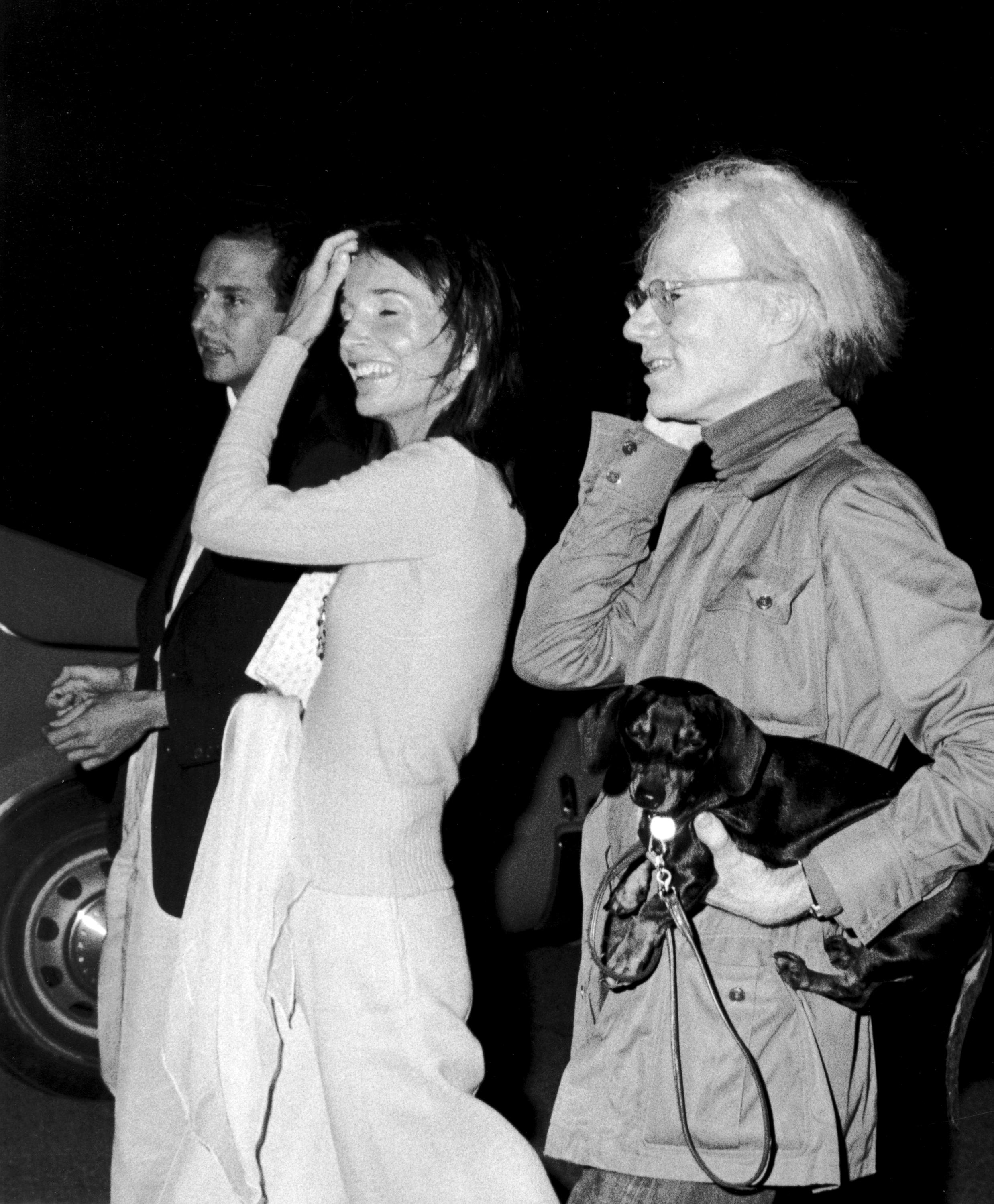 Fred Hughes, Lee Radziwill, and Andy Warhol with dog Archie, Montauk, New York