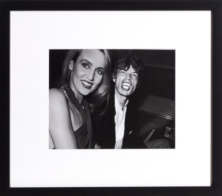 Artist: Ron Galella, American (1931 - ) Title: Limelight - Mick Jagger and Jerry Hall Year: 1984  Published: 2009 Medium: Gelatin Silver Print, signed and numbered in pencil verso Edition: 25 Size: 8 x 10 in. (20.32 x 25.4 cm) Frame: 15 x 17 inches