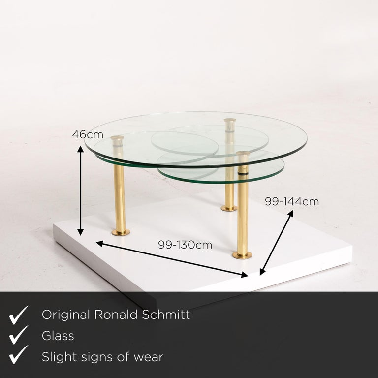 We present to you a Ronald Schmitt glass coffee table gold function adjustable table.     Product measurements in centimeters:    Depth 99  Width 99  Height 46.