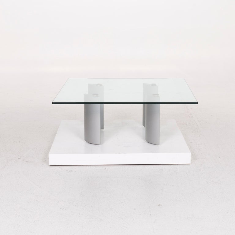We bring to you a Ronald Schmitt silver glass coffee table.  SKU: #12251     Product Measurements in centimeters:     depth: 99  width: 99  height: 38  seat-height:   rest-height:   seat-depth:   seat-width:   back-height: