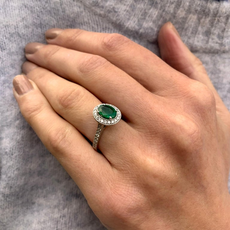 A perfectly proportioned oval shape emerald (1.02ct) sits centre stage in this beautiful ring crafted in 18k white gold. The vintage setting detail is perfect, complimenting the main stone. A perfectly shaped surround and shoulders filled with