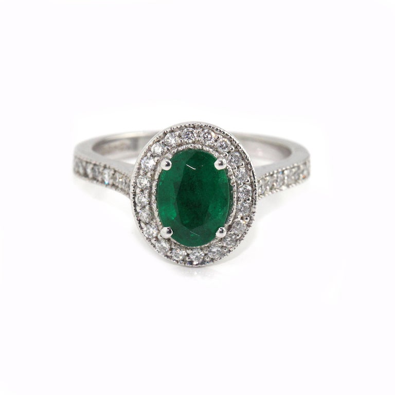 Oval Cut 18 Karat White Gold Emerald and Diamond Ring For Sale