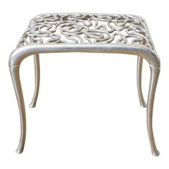 Rondel Design Cast Aluminum Peanut Foot Stool