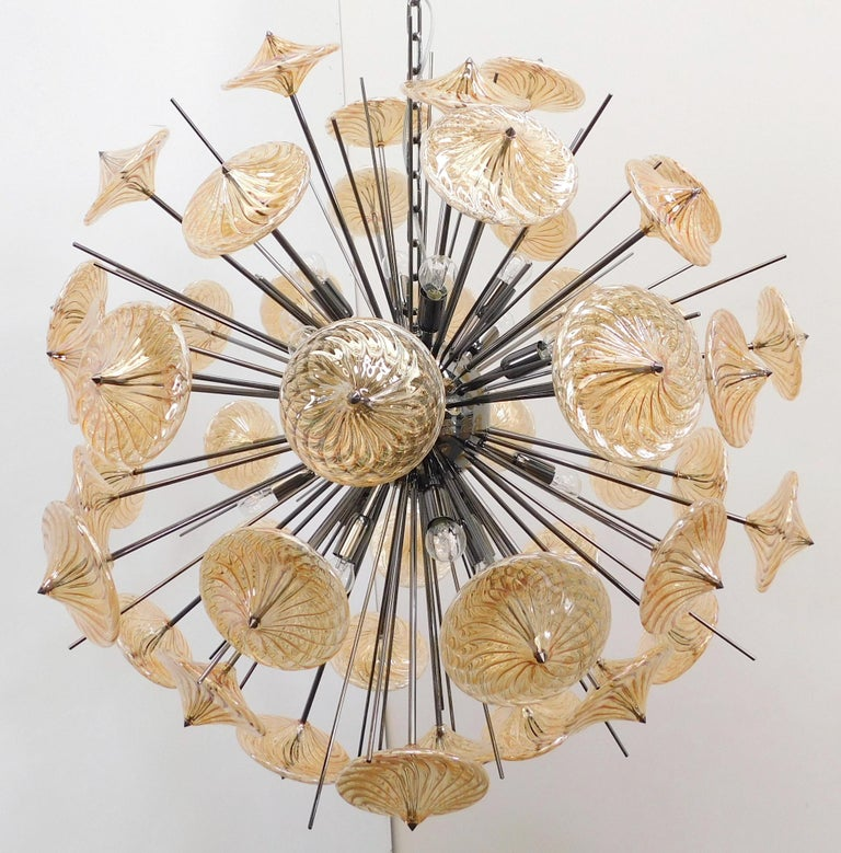 Italian modern Sputnik chandelier shown in amber hand blown glasses on polished black nickel frame designed by Fabio Bergomi for Fabio Ltd / made in Italy 16 lights / E26 or E27 type / max 60W each Measures: Diameter 39.5 inches, height 39.5 inches