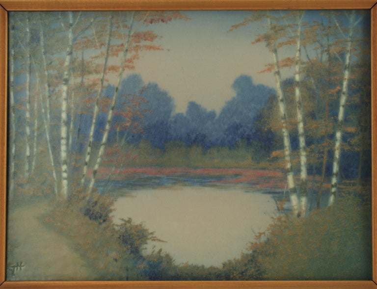 This Classic Rookwood vellum glaze scenic plaque was painted by well listed artist E.T. Hurley in 1945 and is housed in its original wood frame. The plaque features groupings of silvery birch trees growing around a small pond along with a footpath