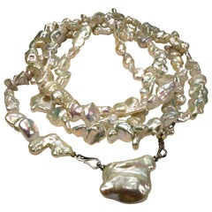 Rope of Iridescent White Baroque Pearls Necklace