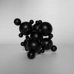 Alien, black interior metal steel table abstract sphere sculpture