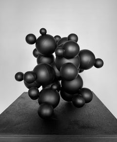 Art Ligand, black interior metal steel table abstract sphere sculpture