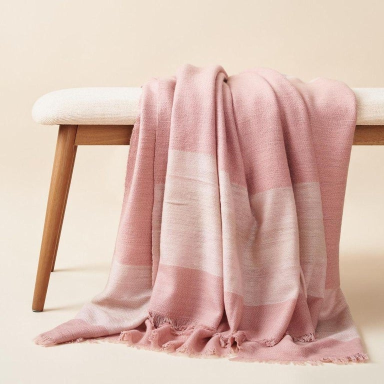Custom design by Studio Variously, Rosa Throw / Blanket / Bedspread is a plush handloom textile ethically woven by master weavers in Nepal and dyed entirely with earth friendly dyes in soft 100% merino yarn.  A sustainable design brand based out of