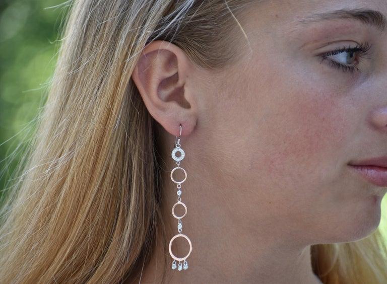 Featuring 14k diamond circle hoop dangle earrings Metal White alternating with rose gold  Earrings 3.25