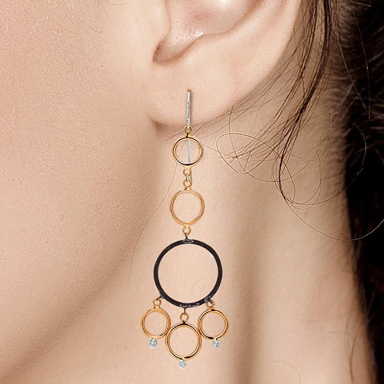 Fourteen karat rose and white gold circles with bezel-set diamonds  Three inch long earrings Two Blacken silver circles   Diamond weight 0.18 carats 14 karat gold large hoops. New Earrings The latest and innovative fashion collections have been