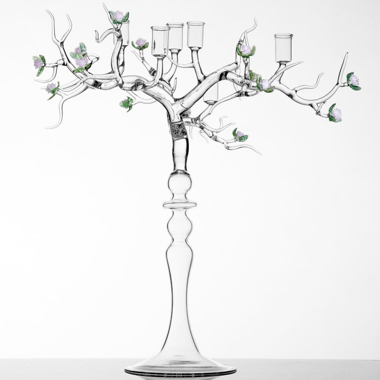 This exquisite candleholder in the shape of a tree is made in borosilicate glass and enriched by decorations in the shape of delicate pink roses blossoming among fine green leaves. The branches hold, at the top, six candleholders.