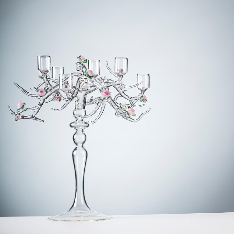 'Rose Candelabra' - handmade glass candelabra The base of a candelabra that changes idea and turns into a tree: a tangle of branches, flowers, and leaves of a flourishing rose garden that brings the beauty of transience into everyday life. The