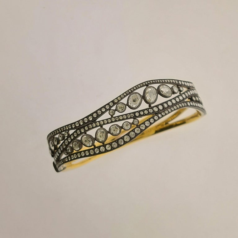This 18K Gold Bracelet has rose-cut Diamonds in oval and round shape. Classic inspiration from British Kingdoms from late 1700's. The total Diamond weight is 4.50cts. This is a bangle bracelet and is in size 7. This is made of 18K Gold, however the