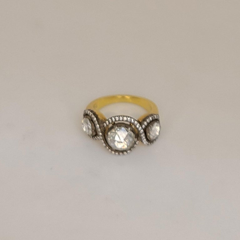 This 18K Gold Ring has 3 rose-cut Diamonds on top. They're 1.33cts total. The Diamonds complementing the rose-cut Diamonds are round brilliants of 0.92cts. This ring is 6.75 in size as is and can be resized upon order. The ring is made of 18K Gold,