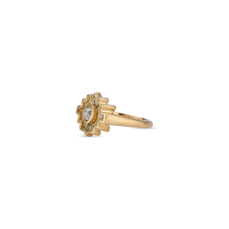 This exclusive design presents the diamond from a new perspective. The central salt and pepper rose cut diamond (approximately .31 carat total carat weight) of this 18k yellow gold ring is a departure from the ubiquitous brilliant cut diamond.  The