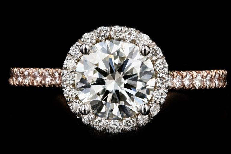 Era: New  Composition: 18K Rose Gold  Primary Stone: Round Brilliant Cut Diamond  Carat Weight: 1.23 Carats  Color: K  Clarity: VS2  Accent Stone: Round Brilliant Cut Diamonds  Carat Weight: .36 Carats  Color: G-H  Clarity: VS1/2  Total Carat