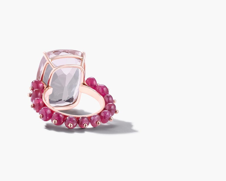 Ruby beads and a beautiful cushion cut rose quartz are set in rose gold.   18K Rose Gold 14.61cts Rose Quartz  9.00cts Ruby Beads  Ring measures US 6.5, can be sized   Each stone is individually selected for its unique beauty Designed and handmade