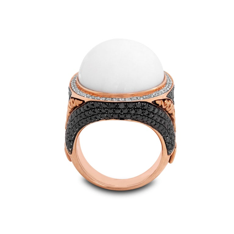 14K Rose Gold White and Black Diamond Ring with White Agate Center  2.22 carat diamonds total weight. Black diamonds are set throughout the ring with white diamonds set surrounding the center White Agate.  Ring face is 1.05 inch by 0.90 inch. 0.40
