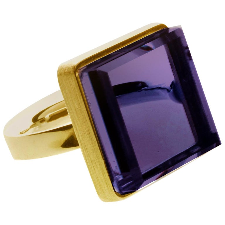 This Art Deco Style men ring is in 14 Karat rose gold with 15x15x8 mm natural amethyst. It was published in Harper's Bazaar and Vogue UA. The piece can be ordered in the other colours, such as green amethyst, rose quartz, blue or green grown quartz,