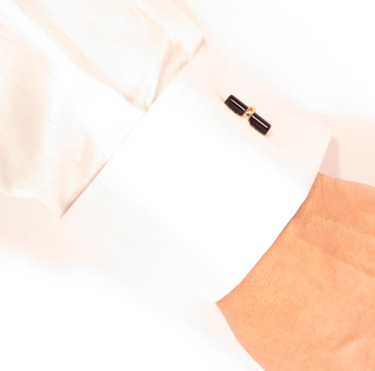 Cufflinks in 9k rose gold with four real onyx bars. Gemstones size is: length 20 mm - diameter 5 mm (length 0.787 inches - diameter 0.196 inches). They are stamped with the Italian Gold Mark 375 and Botta Gioielli's brandmark 716MI. These cufflinks