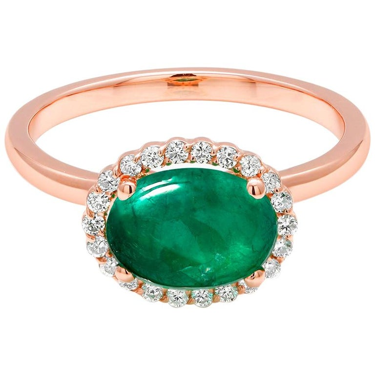 Fourteen Karat rose halo gold ring  Two carat oval shape cabochon emerald Surrounded by pave set diamonds weighing 0.34 carat Ring size 7 In Stock New Ring Ring can be resized