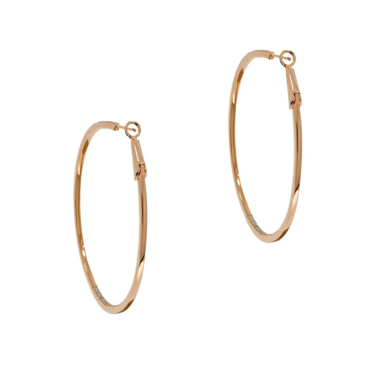 Put that finishing touch on any look, with a spectacular pair of diamond hoop earrings.  Crafted in 18k Rose Gold and finished with a clip type of closure. Perfect for any occasion!!!