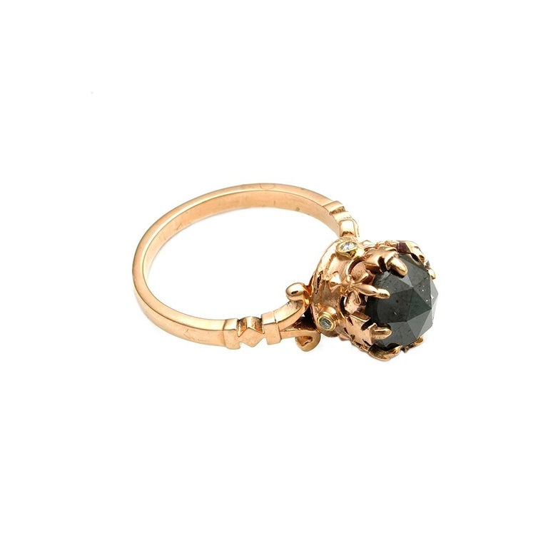 The Opaque Imperial Crown Ring is a one of a kind treasure that fits a size 5 1/8 (Australian & British Size K). Handcrafted from 9ct rose gold this luxurious ring features a central, 8mm, rose cut, black diamond that glistens in an impeccable way.
