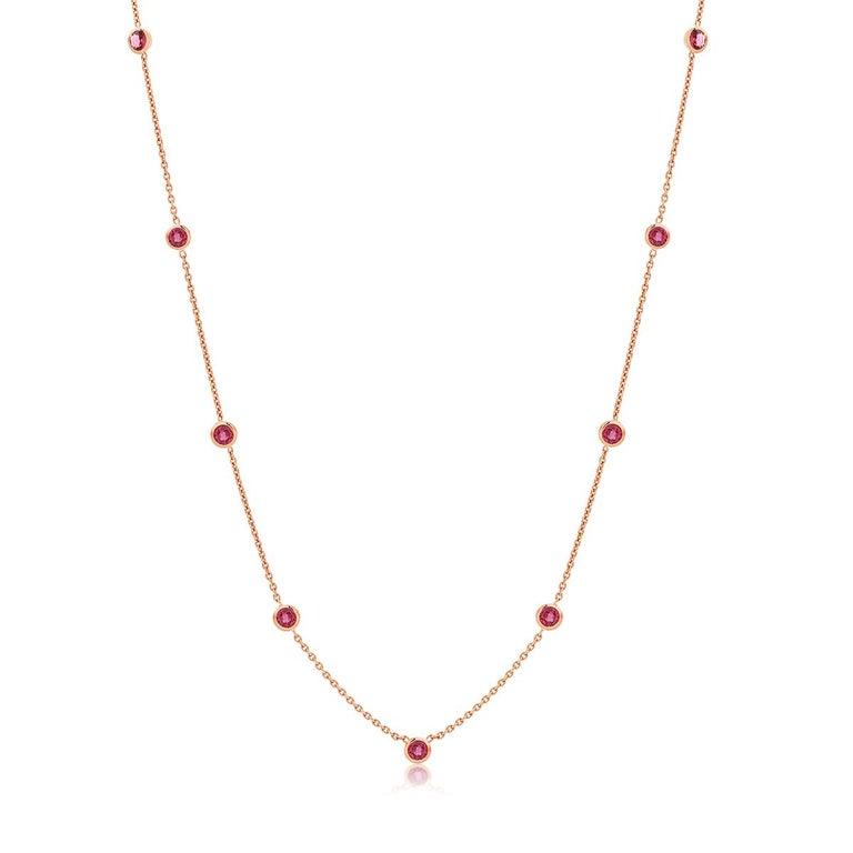Fourteen karat rose gold necklace pendant  Nine bezel-set round bright rubies