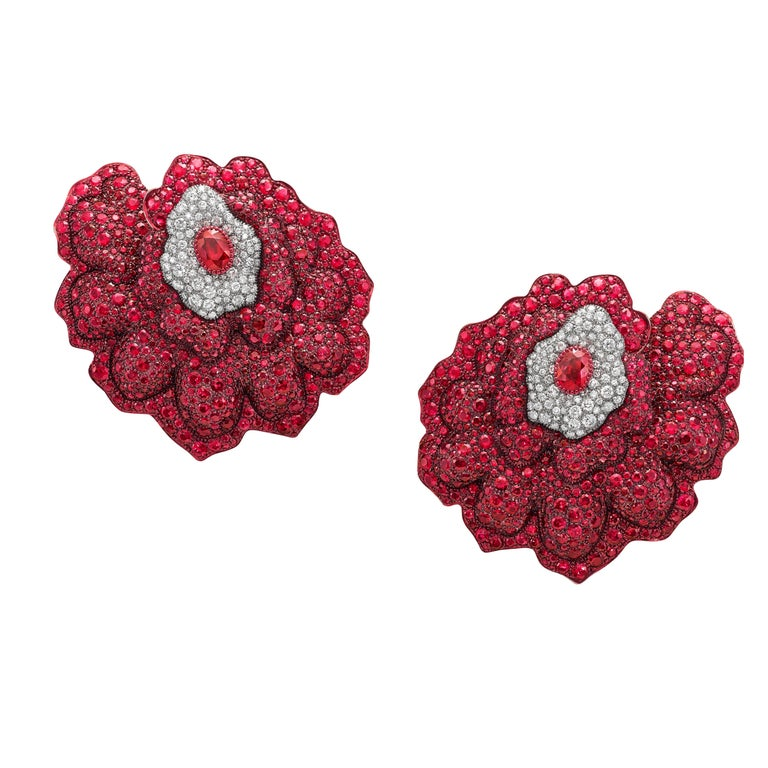 Magnificent flower cuff earrings crafted in 18K rose gold and Titanium                                                      Mozambican responsibly sourced rubies                                                                           Ethically