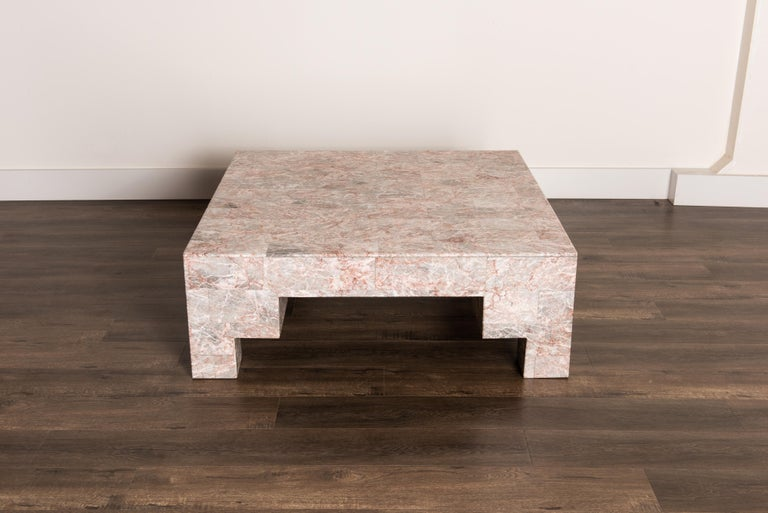 So gorgeous and designer on-trend, this heavy and substantial Post-Modern coffee table is constructed from rose pink and grey marble. The angled and architectural shape makes it perfect for a Postmodern room, while the beautiful marble stone veining