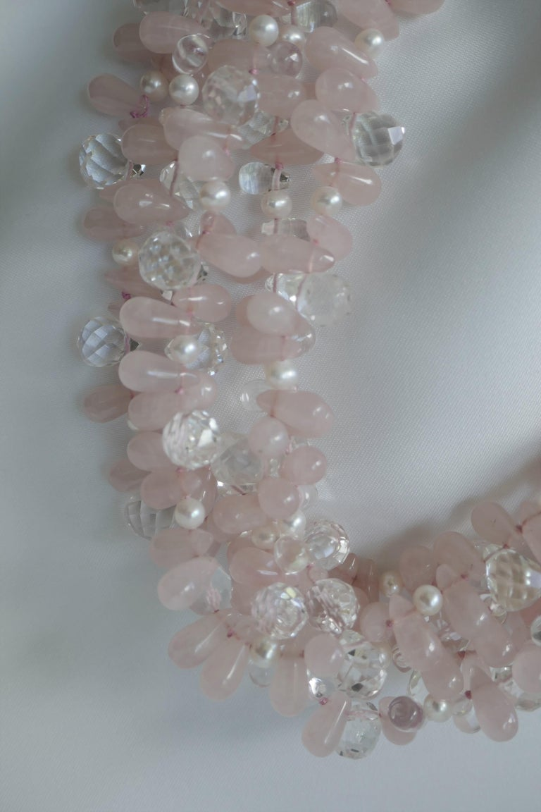 This multi strand (5 strand) rose quartz, rock crystal and white cultured fresh pearl necklace is a statement piece that looks beautiful on. The necklace given the luminosity of the faceted rock crystal and rock crystal briolettes bring this
