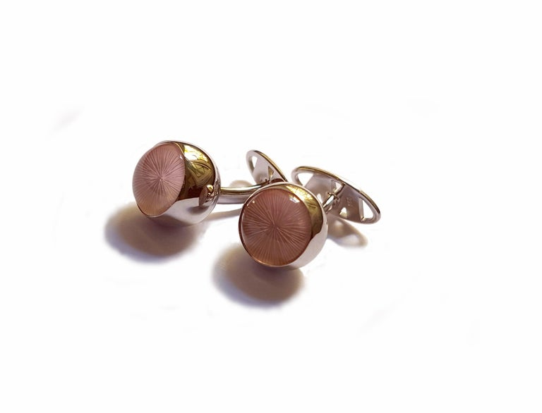 Elegant classical cufflinks designed by Clemens Ritter von Wagner are made of 750/0 white gold. The rose quartz spheres with
