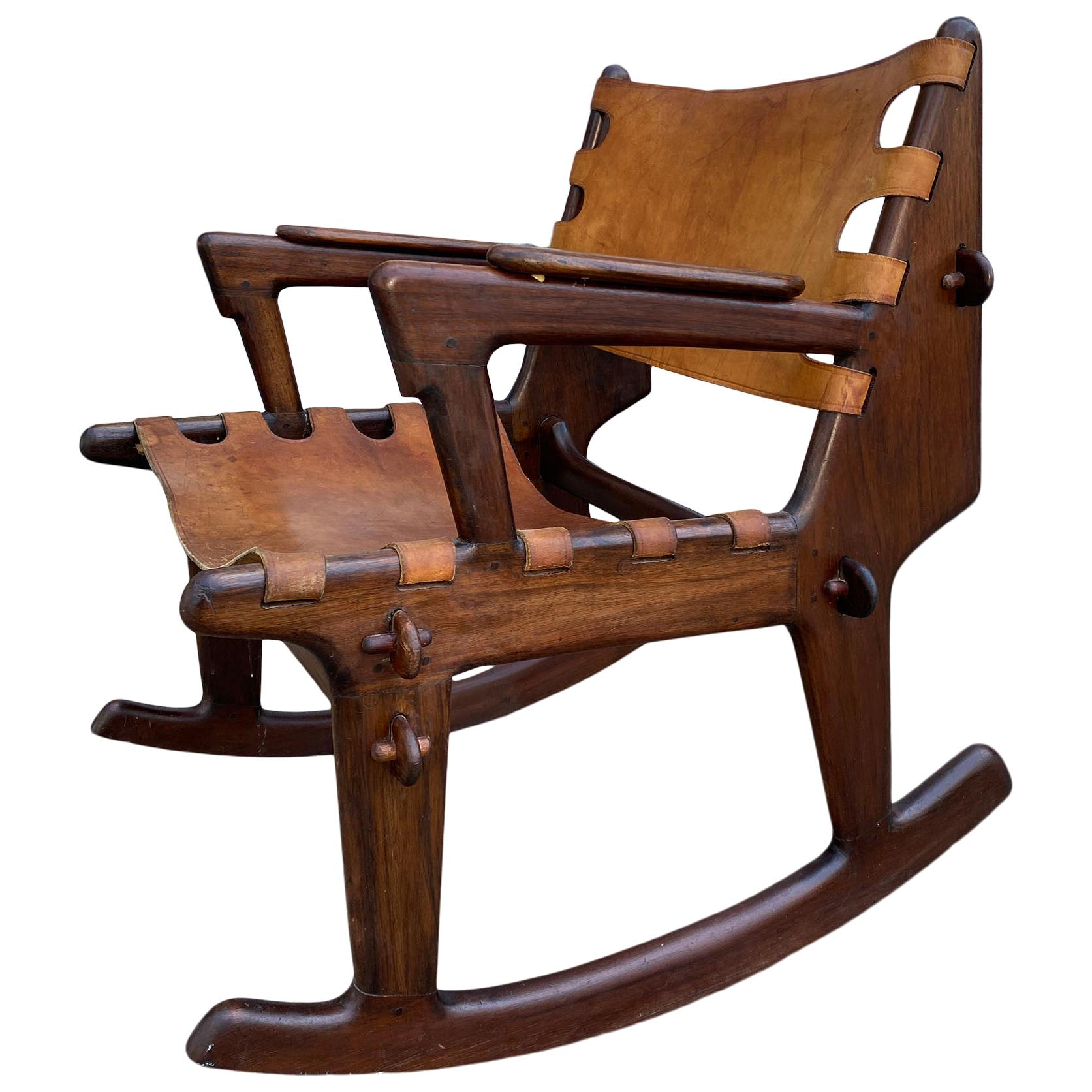 Rose wood and leather sling rocking chair by Ecuadorian designer Angel Pazmino