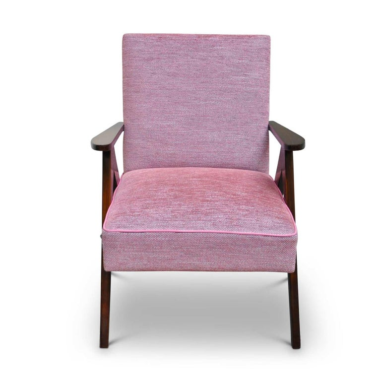 This small armchair is part of the Wow collection and can be displayed in an entryway, living room, or even in the bedroom. The solid beechwood legs are shaped like a compass, seat and back are upholstered in a rose weave of linen and cotton. The
