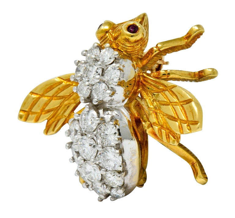 Designed as an insect with polished gold head and wings that are deeply engraved with a harlequin pattern  Round brilliant cut diamonds, set in platinum, weigh in total approximately 2.75 carats; G to I color with VS and SI clarity  Accented with