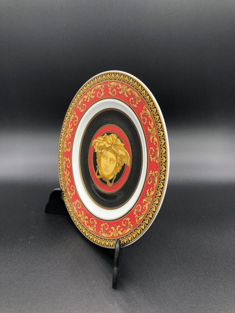 Rosenthal Versace Medusa Plate Boxed. This stunning Versace dinnerware is called Medusa Red. It is produced using the finest porcelain creating a style that is best described as luxurious and glamorous. The bread & butter plate measures 7 inch. The