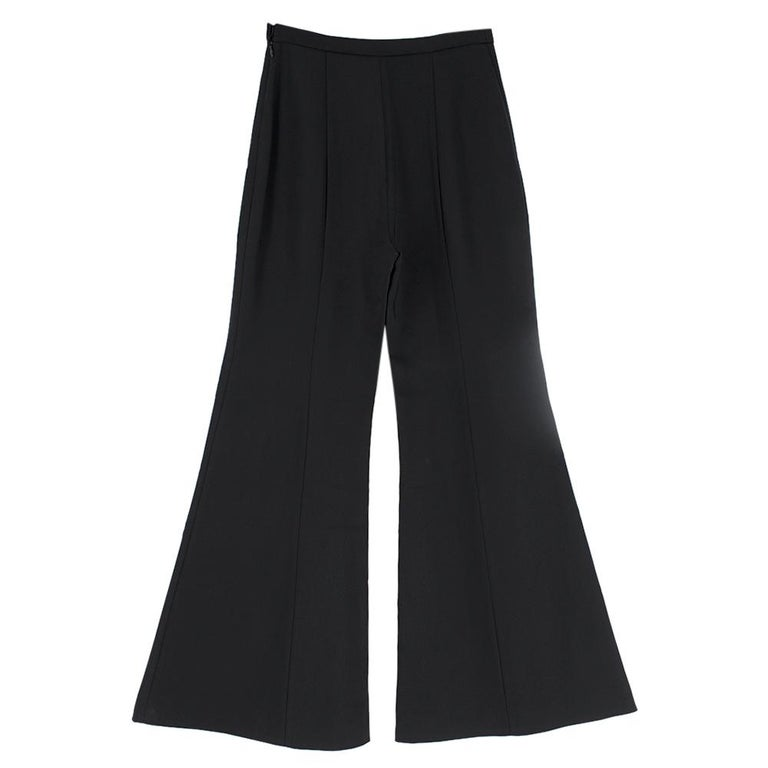 Rosetta Getty Black Jersey Pintuck Flared Trousers  Long, black flare trousers Side zip fastening with metal hook and button closure Pressed creases  Mid-weight material  Please note, these items are pre-owned and may show some signs of storage,