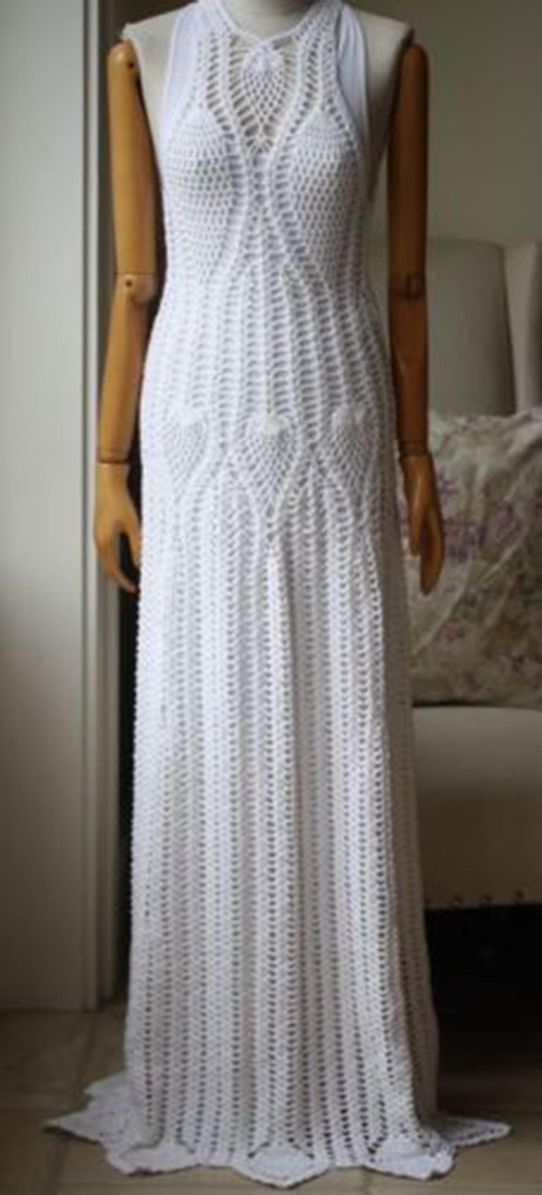 Inspired by a trip to Sayulita, Mexico, Rosetta Getty's ivory dress captures the spirit of youthfulness and travel. This floor-length style is hand-crocheted from glossy cotton-blend and includes a slip for coverage. Ivory crocheted cotton-blend.