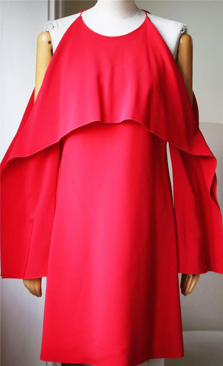 Made from stretch-cady, this dress has a draped overlay that folds over the bodice, cutout shoulders and wide, geometric sleeves. Red stretch-cady. Concealed zip fastening along back. 96% viscose, 4% elastane; lining: 93% silk, 7% spandex. Designer