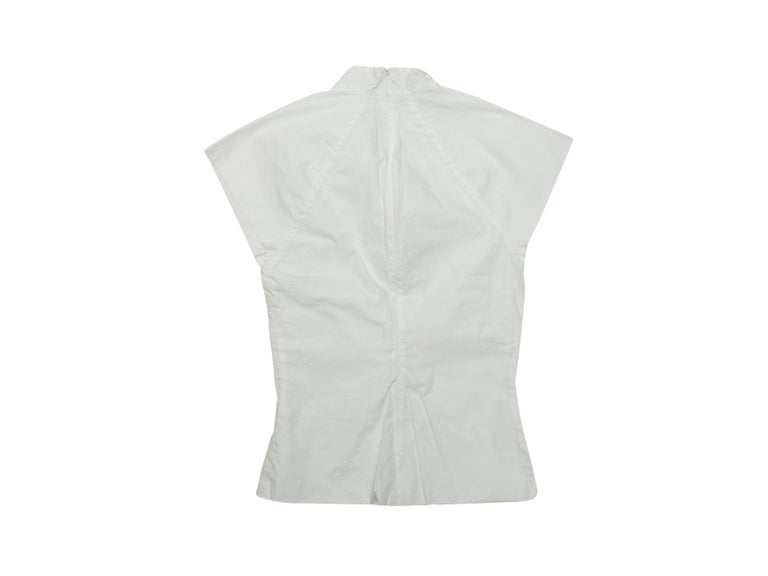 Product details: White cap sleeve top by Rosetta Getty. Mock neck. Concealed zip closure at nape. 32