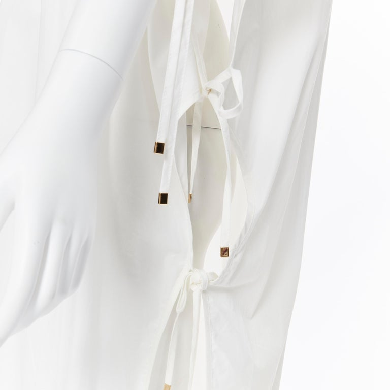 ROSETTA GETTY white cotton gold harware tie side high low casual dress XS Brand: Rosetta Getty Designer: Rosetta Getty Model Name / Style: Dress Material: Cotton Color: White Pattern: Solid Extra Detail: Tie side detail. Gold-tone