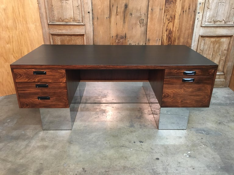 Rosewood and chrome executive desk with ebonized wood top.