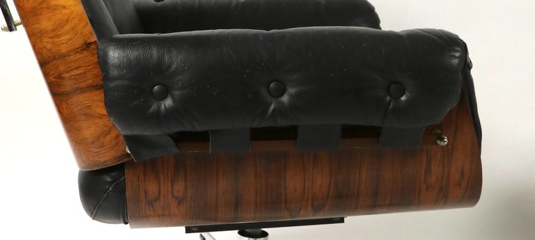 German Rosewood and Leather Eames Style Swivel Lounge Chair and Ottoman For Sale