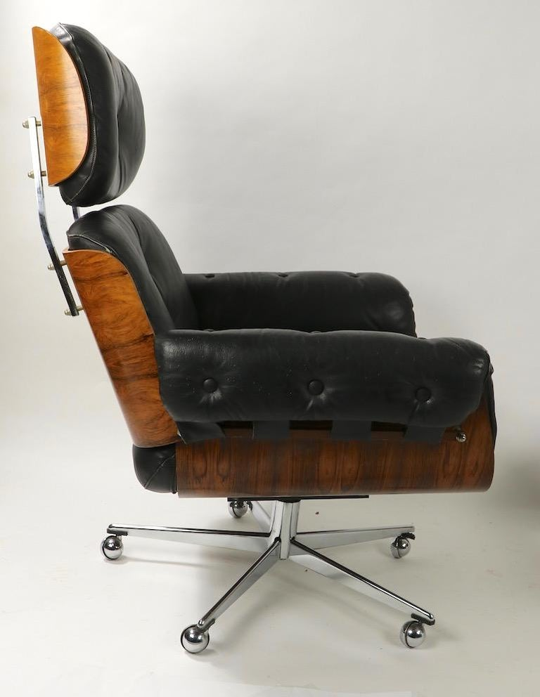 20th Century Rosewood and Leather Eames Style Swivel Lounge Chair and Ottoman For Sale