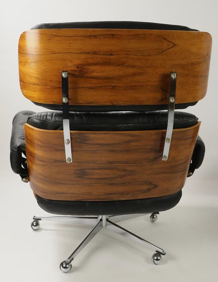 Rosewood and Leather Eames Style Swivel Lounge Chair and Ottoman For Sale 2