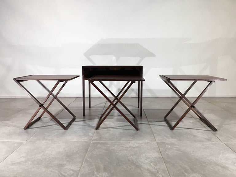 Beautiful set of three cased nesting tables in rosewood and oak designed by Illum Wikkelso for Silkeborg, Denmark, circa 1960.